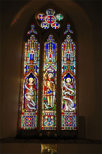 Stained glass window showing St michael (centre panel)